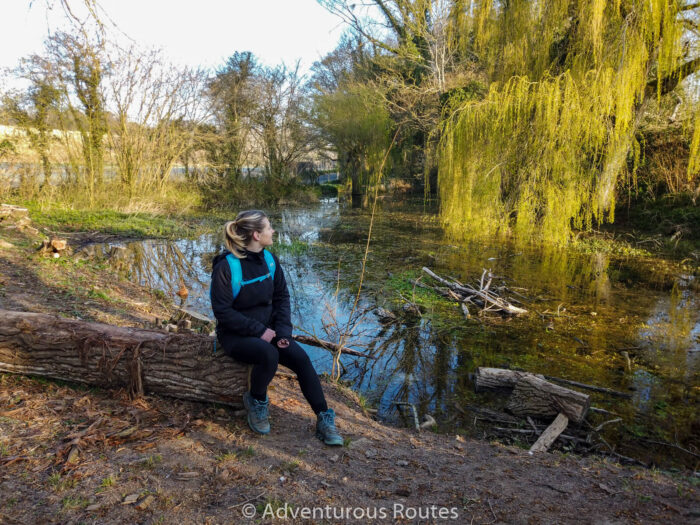 person in front of the spring of the river itchen