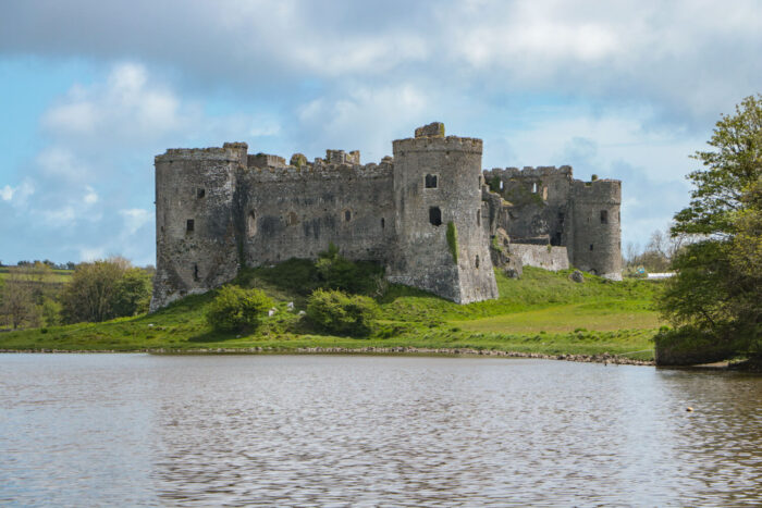 Carew Castle in Wales, built on the shore of a millpond