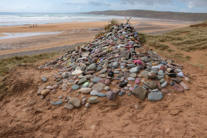Pile of stones that mark the fictional burial site of Dobby the elf in Freshwater West, Wales